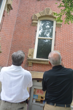 Architect Pat Kelley of Kelley Architectural Services and Commissioner Dane Shryock examine the exterior of the Coshocton County Courthouse.