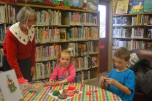 Patty Thompson helped with the children's crafts at the annual West Lafayette Library Holiday Open House on Saturday, Dec. 3. Beth Scott | Beacon