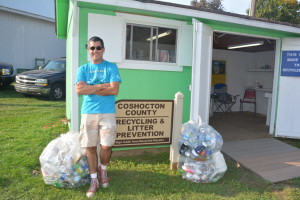 RECYCLING: Jeff Wherley stands with bags of recyclables on the last day of the Coshocton County Fair. He said that more than 100 pounds of materials were recycled this year at the fair. BEACON PHOTO BY BETH SCOTT