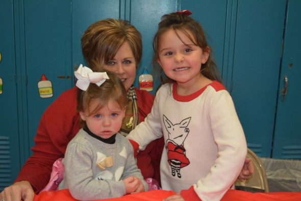 Pictured here is Gabriella Sturtz, age 2, with her sister Pressly Wise-Sturtz, who is in Carolyn Wilson's preschool class with grandmother, Beth Sturtz at the Ridgewood preschool's Christmas lunch on Monday, Dec. 21. Also attending was brother, Swayze Stine, who is not pictured.