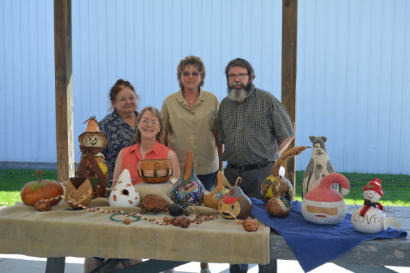 Pictured from l-r: Theresa Scheetz, Norma Owens, Diana Swigert, and Ron Cummings. This dedicated group makes decorative gourds for the Coshocton County Fair. They are trying to create more interest in gourd decorating.
