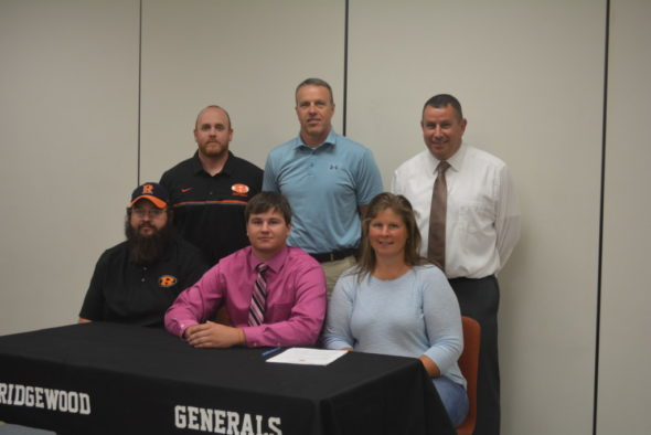 Keith Leindecker signed with Walsh University on Wednesday, May 24 at Ridgewood High School. He will be playing defensive line and specialty teams on Walsh's football team. Beth Scott | Beacon
