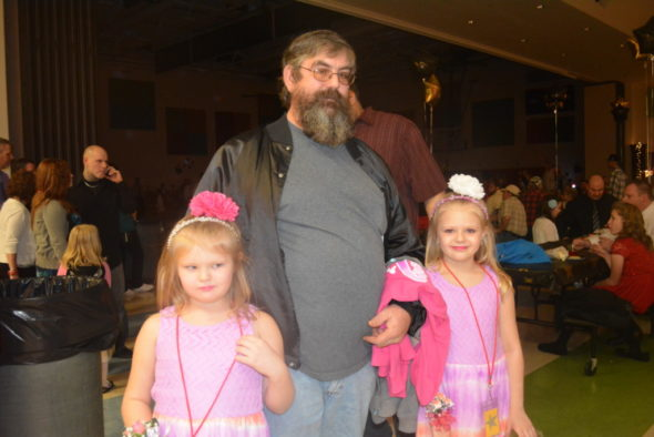 Bayleigh Cunningham and Jayleighn Cunningham attended the father/daughter dance at Coshocton Elementary with their grandfather, Kevin Cunningham.