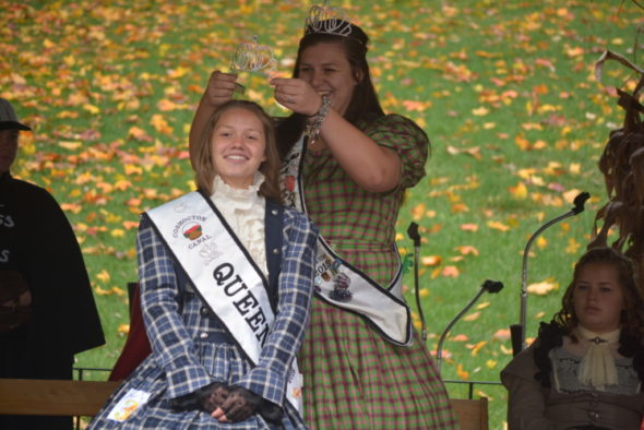 The 2015 Canal queen, Kristian Meek, crowns Megan Stonebraker as the 2016 Canal queen during the Apple Butter Stirrin' Festival on Saturday, Oct. 22, 2016.