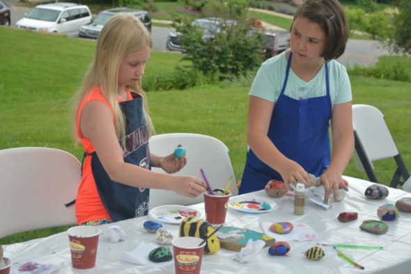 Natalie Strange and Hannah McVay enjoyed painting rocks together on June 6 at Clary Gardens. Josie Sellers | Beacon