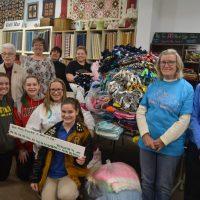 Volunteers make blankets in honor of Ava Winner