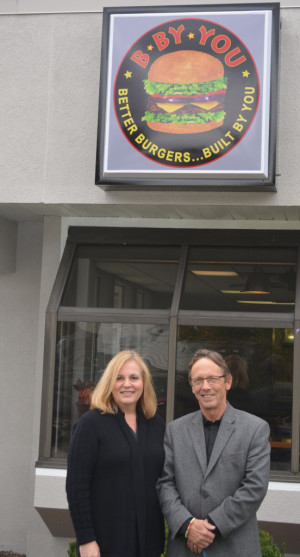 Owners: Linda and Mike Comella are excited to open B By You this month at the site of the former Arby's on Second Street. They operated Arby's in Coshocton for 20 years, but felt it was time to offer the community better burgers built by themselves. Beacon photo by Josie Sellers