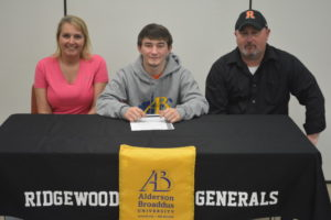 Colton Bethel, center, signed his letter of intent to wrestle at Alderson Broaddus University. The Ridgewood High School senior is pictured here with his stepmother Kelly Bethel and father Tim Bethel. Josie Sellers | Beacon