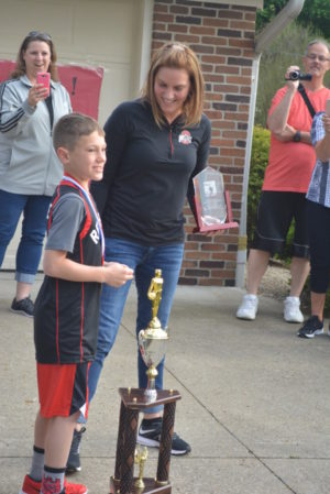 Colton Conkle and his mom Tiffany were all smiles after thanking everyone who came to welcome him home from the Elks National Hoop Shoot contest, where he earned the national title for his age division. Josie Sellers | Beacon