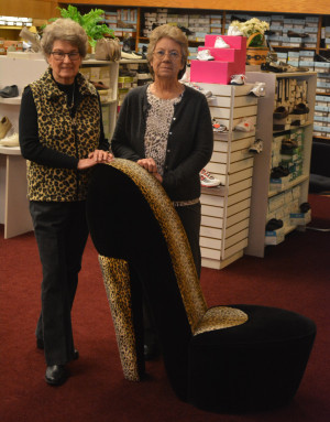 Merger: Carton's Shoes is in the process of merging with Golden's. Both Main Street businesses are owned by Lynn and Jerry Weaver. Pictured are Lynn Weaver and Golden's manager Florence Whitcomb. Beacon photo by Josie Sellers