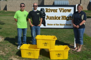 With the help of Jeff Wherley from the Coshocton County Recycling & Litter Prevention Office, Michelle Zimmerman, a teacher at River View Junior High, was able to get 24 new containers for the school's recycling program that Kimble donated on Aug. 1. Pictured are Wherley, Andrew Kimble, from Kimble and Zimmerman. Josie Sellers | Beacon