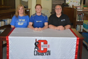 Swimmer: Coshocton High School senior swimmer Bryce Philabaum signed his letter of intent to swim at Urbana University on April 18 in the library at CHS. Pictured with Philabaum are his mother and father Cathy and Steve Philabaum. Beacon photo by Josie Sellers