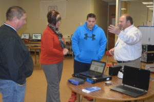 Bart Winegar (far right) discusses the Coshocton County Career Center's new Networking Information Computer Systems program with John, Becky and David Mason at the school's parent information night. David, a sophomore at Ridgewood High School, is considering finishing out his high school career at the Career Center. Josie Sellers | Beacon
