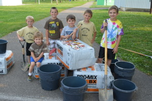 Gardeners: The Duncan family started its Sunflowers on Seventh beautification project June 9. Pictured smiling for the camera before they started planting are: Eli Duncan, who was sitting in front, and then from left are Greyson Schultz, Caleb Kline, Cooper Duncan, Caleb Schultz and Noah Duncan. Beacon photo by Josie Sellers