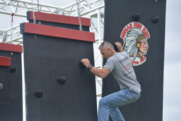 Hubie Cushman is pictured working his way down the Indian Mud Run's floating wall obstacle that he created. The obstacle will be featured at this year's event, which will be held Saturday, June 24. The obstacle race will start and end at the former Hilltop Golf Course across from Lake Park. Josie Sellers | Beacon