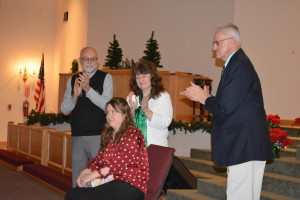 Surprise: The Coshocton Christian School had a surprise going away party Dec. 16, for high school teacher Tara Parson. Pictured in front is Tara and in back, from left, are her parents Dan and Wendy and Principal Stan Zurowski. Beacon photo by Josie Sellers