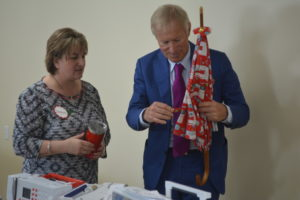 Dawn Krier from Chestnut Ridge Sewing presented Hanspeter Ueltschi, the owner of Bernina, with a special gift made by Angie Schmoldt. Ueltschi came to the store to visit with customers and celebrate its successful sales of Bernina products to customers. Josie Sellers | Beacon