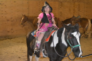Trick or Treat: McKenzie Clapper dressed up as a witch for the Halloween Party at Higher Hopes Therapeutic Riding Center. Participants in the program were invited to bring their families with them Monday evening, Oct. 26 to enjoy trick or treating on horseback and refreshments. Beacon photo by Josie Sellers