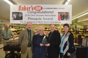 AWARD: Gary and Terrie Baker, owners of Baker's IGA, received the prestigious Pinnacle Award from the Ohio Grocers Association at a special ceremony held at the Newcomerstown store on Tuesday, Jan. 19. Pictured from left are: Mark Cutshall, Director of Store Operations for Baker's IGA; Terri and Gary Baker; and Kristin Mullins, President & CEO of the Ohio Grocers Association. Beacon photo by Beth Scott