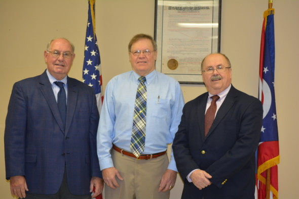 Pictured l-r: Bill Owens, village solicitor, former mayor Jack Patterson, and Mayor Stephen Bordenkircher at the swearing-in ceremony on Thursday, Dec. 31.