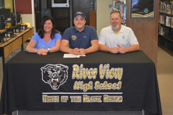 Jake Moore, center, signed his letter of intent to golf at Kent State Tuscarawas on April 26 in the library at River View High School. Pictured with him are his mother Desiree Moore and his father David Moore. Josie Sellers | Beacon
