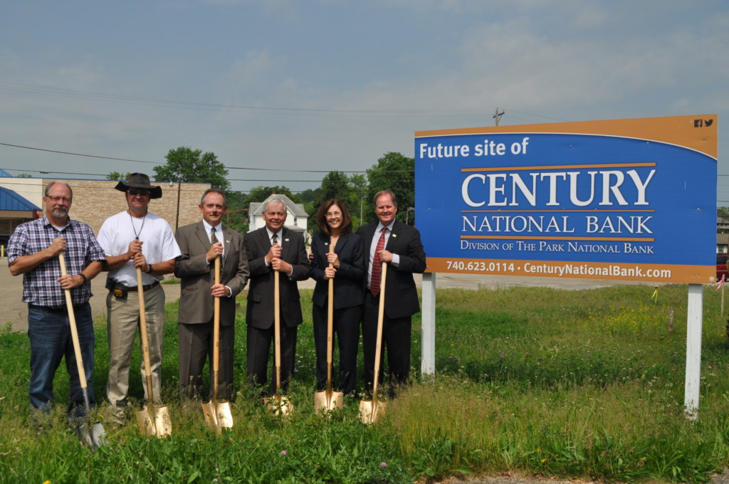 Century National Bank officers broke ground at the Third Street site of an additional $1.2 million dollar branch office in Coshocton on Friday morning, May 19 with city officials and members of the community applauding the expansion. Left to right; Bruce Widder, Architect, BA Widder Architectural Services, Craig Baldwin, Baldwin Construction, Bob Bigrigg, Vice-President, Century National Bank, Tom Lyall, Chairman of the Board, Century National Bank, Beccy Porteus, Vice-President, Northern Division of Century National Bank and Pat Nash, President & CEO of Century National Bank. Mark Fortune | Beacon