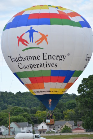 People were able to take a tethered balloon ride on June 9 at the Coshocton Hot Air Balloon Festival in the Touchstone Energy Balloon for a $20 donation to the Frontier Power Community Connections Fund.  Josie Sellers | Beacon