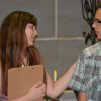 Youth putting on murder-mystery comedy
