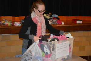 Clothing drive: Jodi Shrimplin, a graduate of River View High School and a substitute teacher, collected clothing for children and then handed it plus coats, winter accessories, shoes, socks and underwear out on Feb. 18 at Union Elementary School. Beacon photo by Josie Sellers