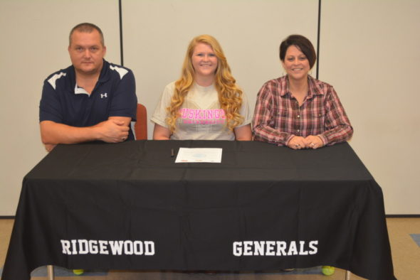 Josey Lillibridge, center, signed her letter of intent to throw shot and disc at Muskingum University on March 31 at Ridgewood High School. At her left is her stepfather Ed Huff and at her right is her mom Michelle Huff. Lillibridge is a senior at Ridgewood.