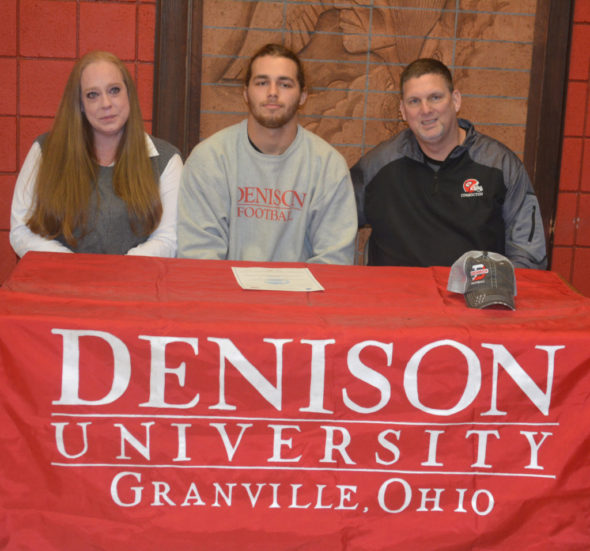 Dallas Griffiths, center, signed his letter of intent to play football at Denison University on Feb. 8 at Coshocton High School. He is pictured with his mother Amber Griffiths and Coshocton's head football coach Jim Woodrum. Josie Sellers | Beacon