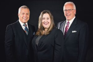 Given-Dawson Funeral Home on Park Avenue recently changed its name to Given-Dawson-Paisley Funeral Home to recognize the continued leadership of Jessica Paisley, general manager and licensed funeral director. Pictured from left are Bill Given, Paisley and Bob Given.  Contributed | Beacon