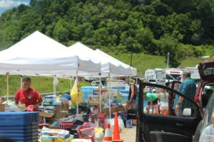 Larene Debnar-Hall, her son, grandson and French foreign exchange student took a vehicle full of supplies to a relief center in West Virginia where they pitched in and helped hand out supplies to flood victims. Contributed   Beacon