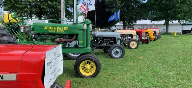 Antique tractors and equipment displayed at fairgrounds