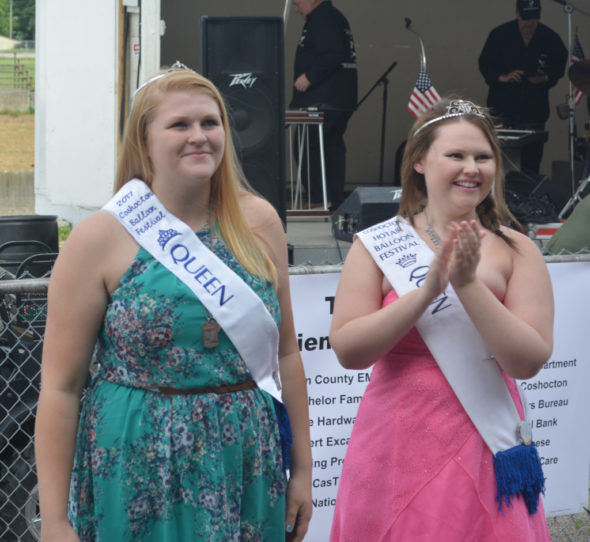 Candace Cormack, right, clapped for Josey Lillibridge, who was just crowned the 2017 Coshocton Hot Air Balloon Festival queen. Cormack represented the festival as the 2016 queen. Josie Sellers | Beacon