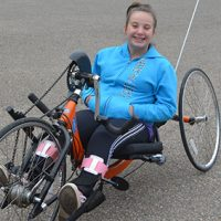 Resident with spina bifida receives new adapted bike