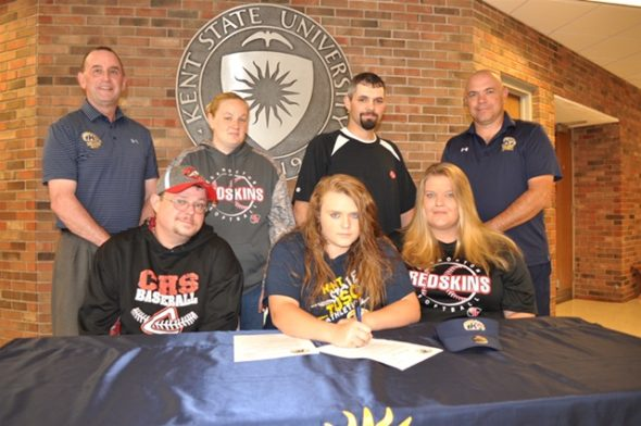 Signing a letter of intent is: Kelsey Crown (center) seated beside her are her father Justin (left) and mother Heather Lauvray. Standing are Kent State Tuscarawas Athletic Director Rob Brindley, Nikki Crown (Kelsey's stepmother), Wayne Lauvray (Kelsey's stepfather), and Kent State Tuscarawas Softball Coach Chuck Peach. Contributed | Beacon