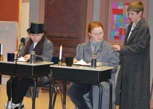 """Theater: Ian McCurdy, Tara Sipes and Ashton Grindle practice a scene from """"A Christmas Carol"""" on Dec. 9. The Ridgewood Middle School students and their fellow cast and crew mates did a dress rehearsal of the play for the district's third graders. Beacon photo by Josie Sellers"""