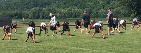 Players stretch with one another during the RVHS football camp put on by Head Coach Bob Forgrave and his coaching staff on Tuesday, June 21. Andrew Everhart | Beacon