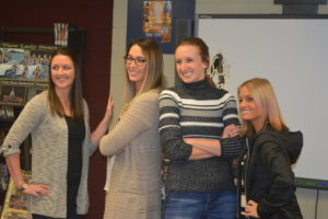 Ashley Owen Conidi, Brittany Bailey, Kristin Daugherty Ronai, and Sami Dickerson Chrisman recreated the pose from their senior basketball season picture during a reunion organized for River View High School's 2006 and 2007 Division II Girls State Championship teams. Josie Sellers | Beacon