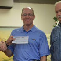 Rotary Club presents checks