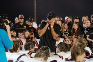 Ridgewood High School Head Football Coach John Slusser is pictured addressing his team after they beat River View 42-0 on Sept. 9. The victory was Slusser's 100th with Ridgewood. Cortney Ringwalt | Beacon