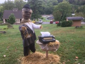 Scarecrow Clark, who boldly states that print is not dead, is one of close to 20 scarecrows on display at Clary Gardens during the month of October. File Photo | Beacon