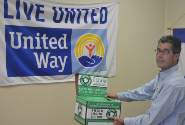 Jeff Wherley from the Coshocton County Recycling & Litter Prevention Office is pictured holding the box at the United Way Office of Coshocton County where disposable batteries and cell phones can be placed for recycling. The United Way location is just one of several recycling locations in the county for these items. Josie Sellers | Beacon