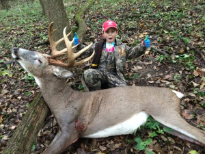 Big buck: Caleb Kline, 7-years-old and from Coshocton, recently shot his first buck. He was hunting with his dad on Oct. 2, when this buck walked in at 6:30 p.m. Photo contributed to The Beacon