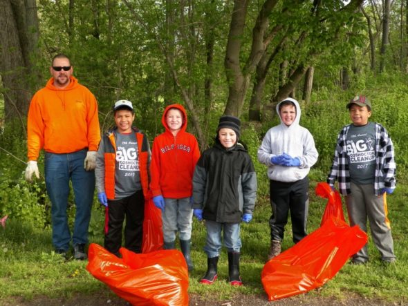 Boy Scouts from Pack 409 cleaned up the area behind the plaza during Clean-Up Coshocton. The scouts are, left to right, Leader Jim McCoy, Anthony Wilkins, Rhett Reynolds, Landon Williams, Reed Shroyer and Daniel Wilkins.