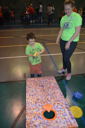 Cornhole: Sarah Stockdale, right, smiles while watching Ashton Buckohr play cornhole on March 17 at the 22nd annual Kiwanis Special Olympics Track & Field Day at Kids America. Beacon photo by Josie Sellers