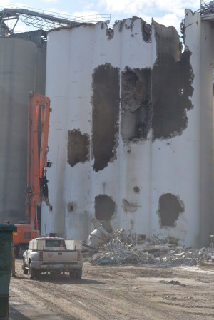 Demo: Eslich Wrecking Company from Louisville spent part of the winter and spring doing demolition work for Coshocton Grain Co. Beacon file photo