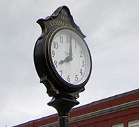 Our Town Coshocton installs clock on Main Street
