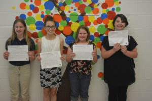 Winners of the Coshocton County Board of Developmental Disabilities essay contest are pictured from left: Kamryn Miller, fifth grade Coshocton Christian School; Vivian Heddleson, sixth grade Union Elementary; Gracie Sipe, fifth grade Union Elementary; and Rose Seioh, fifth grade Ridgewood Middle School. Winners not pictured are: Jaylynn Hewitt, fifth grade Conesville Elementary; Bridgette Bible, fifth grade Keene Elementary; and Kya Masloski, fifth grade Ridgewood Middle School. Josie Sellers | Beacon